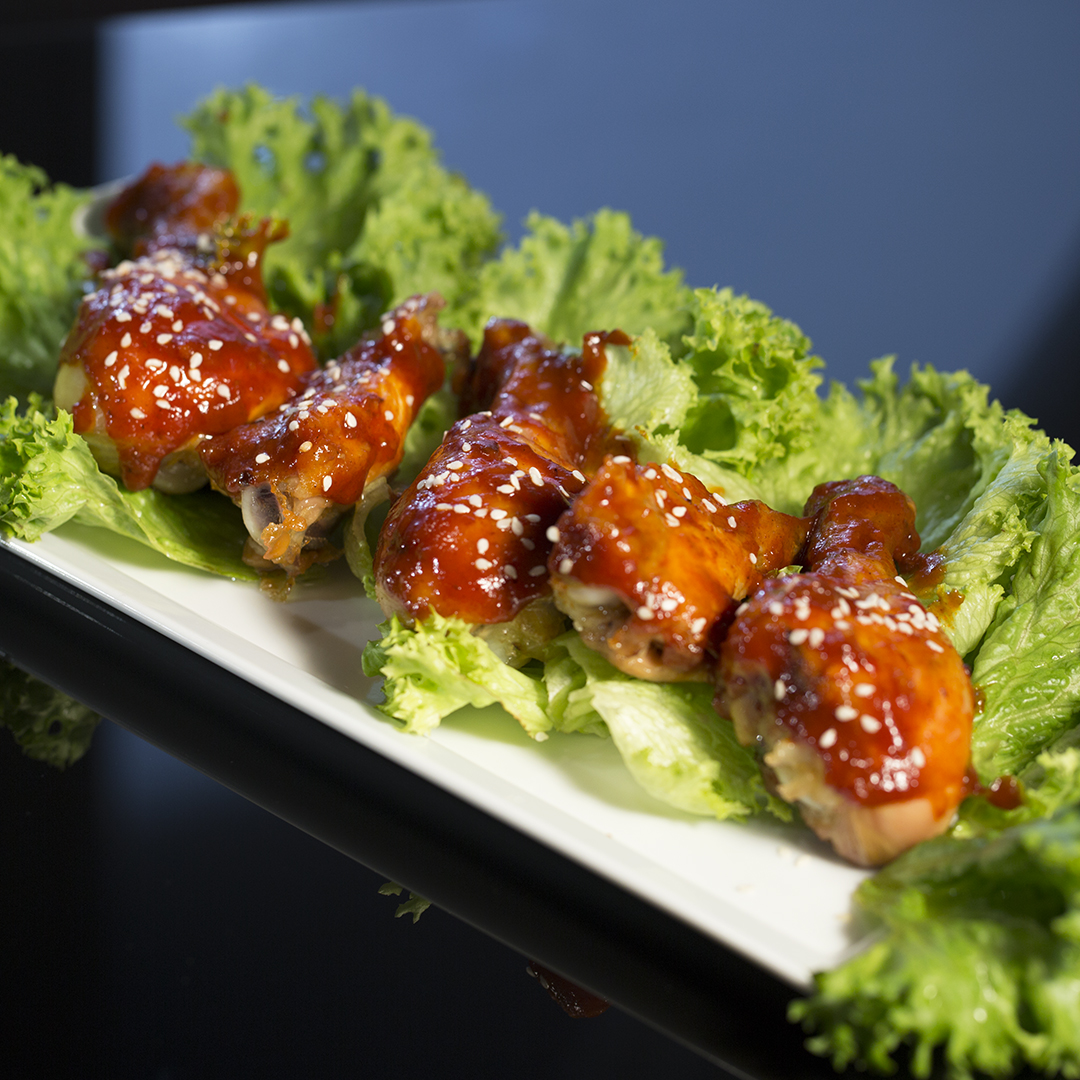 Barbecue-Glazed Chicken Wings and Thighs