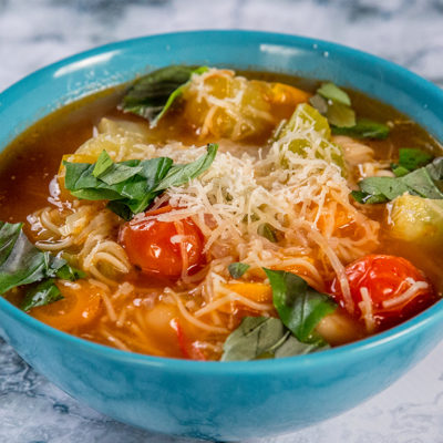 vegan soup with cabbage and cherry tomatoes